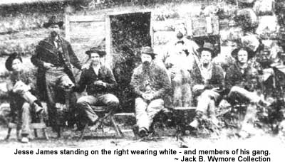 Jesse James standing on the right wearing white - and members of his gang.